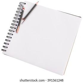 Closeup image of broken black pencil on blank white paper