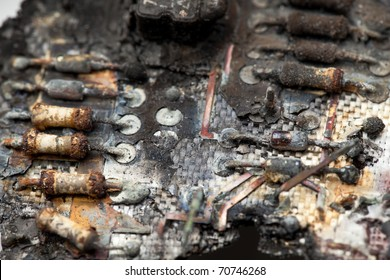 A close-up image of burnt components of a circuit board. / BURNT CIRCUIT 2