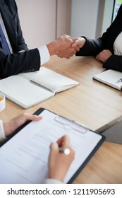 Close-up image of business partners shaking hands to confirm deal