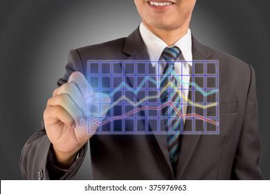 Closeup image of businessman drawing business graph.