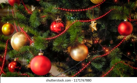 Closeup image of Christmas tree with red and golden balls