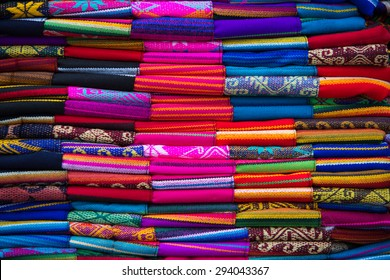Closeup image of classical colorful Peruvian and Bolvian clothes and handicraft at the indigenous market in Otavalo. Ecuador 2015.