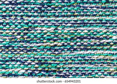 Closeup image of colorful Indian carpet as an abstract textile background.