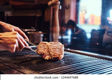 Close-up image of a cooking delicious meat steak on a grill
