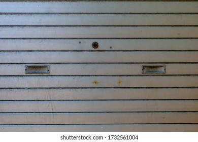 Closeup Image of Corrugated Metal Sheet. Dirty and Grungy Silver Rolling Shutter Texture.
