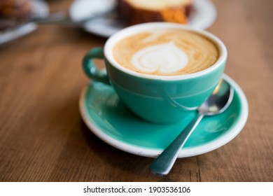 Closeup image of a cup of milk coffee
