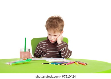 closeup image of the cute displeased little boy painting