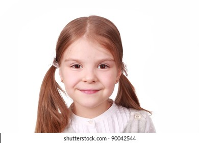 Closeup image of cute smiling little girl on a white background/Head of a little girl