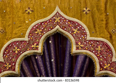 Closeup image detail of Indian fabric used in the decor of a wedding