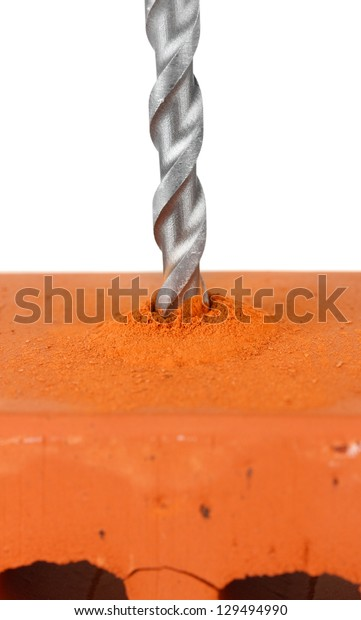 Close-up image of drilling hole on brick, isolated on a white