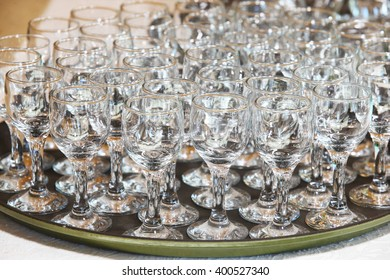 Closeup image of empty stemware standing on a black table