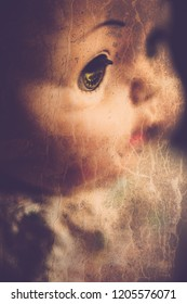 A closeup image of a face on a creepy doll, perfect for Halloween.