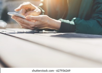 Close-up image of female hands using smartphone with city in the background, Hipster woman typing message to his friends from her smart phone, Searching or social networks concept