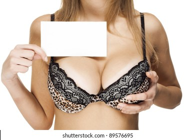 closeup image of a female sexy big breast with business card
