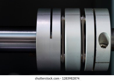 A close-up image of the flexible shaft coupling installed on reduction gearbox and stepping motor shaft for torque reduction of the different load between the drive shaft and the driven shaft.