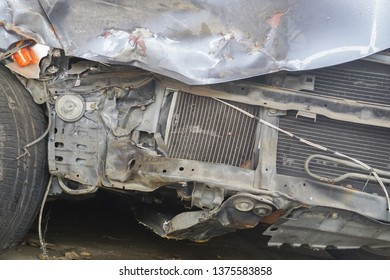 Close-up image of front car damage cause by accident or collosion.