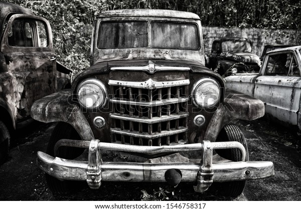 Close-up Image of the Front of an Old Scrap Truck in a Junk Yard