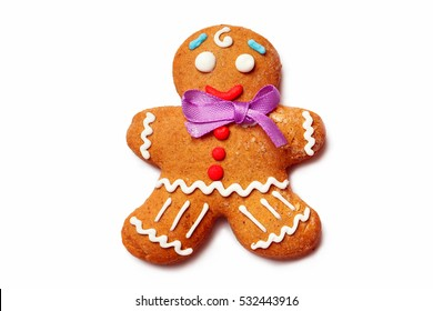 Closeup image of gingerbread man isolated at white background.