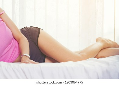 Closeup image of a girl lying on bed in a seductive and sexually attractive