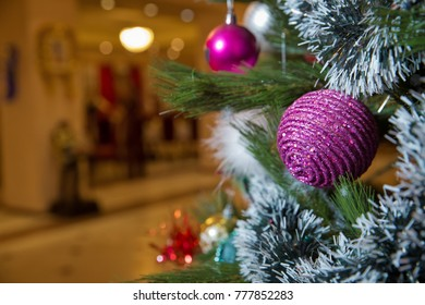 Closeup Image Of Golden And Red Baubles On Christmas Tree In Front Of  Burning Fireplace.