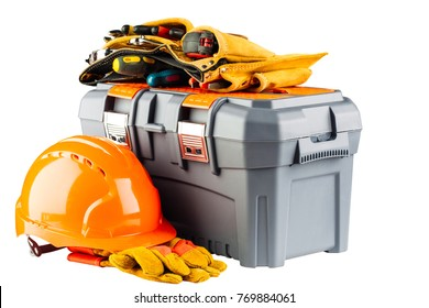 Close-up image of a grey toolbox with orange helmet and yellow toolbelt