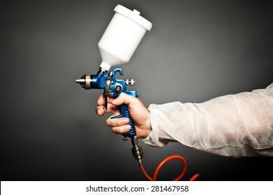 closeup image of hand hold spray gun