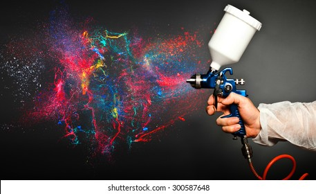 closeup image of hand hold spray gun