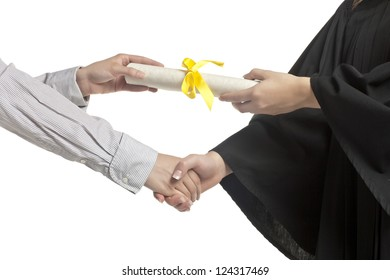 Close-up image of a hand of student receiving a graduation certificate