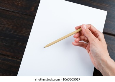 Closeup image of hand writing down on a blank. mockup Top view of female hands making some notes  work, studying, shopping, blogging concept. Mock up, copy space for your text.