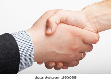 Close-up image of a handshake of businessmans after the deal
