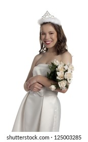 Close-up image of happy prom queen smiling on a white surface