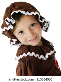 "Closeup image of a happy young ""gingerbread girl.""  On a white background."