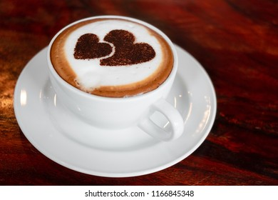 Closeup image hot capuchino coffee on vintage wooden table
