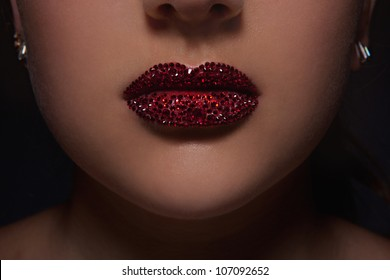 Close-up image of lips with Swarovski crystals