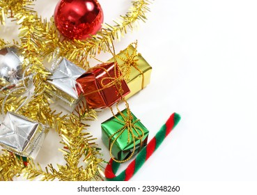 closeup image of little gift box gold green red and silver color for christmas