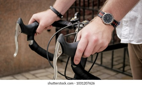 Closeup image of male hands on vintage bicycle handles