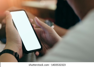 Close-up image of male hands using smartphone, searching, send an email or social networks concept.