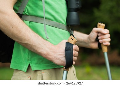Close-up image of man hiker holding hiking poles