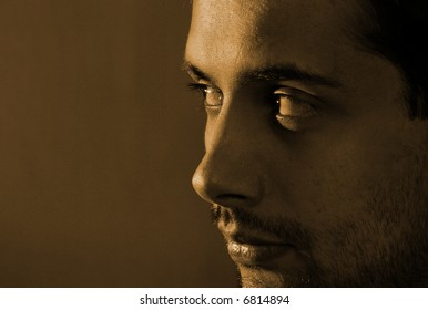 Close-up image of a man isolated on blue