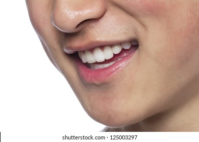 Close-up image of a man's lips with a smile over the white surface