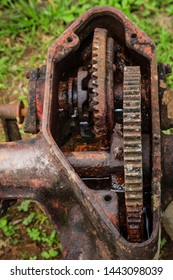 Close-up image of an old open rusted gearbox