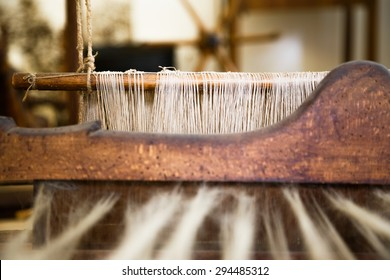 A closeup image of an old weaving Loom, details.