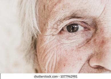 Close-up image of old woman's eye, looking at camera