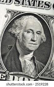 Closeup image of a one dollar bill.