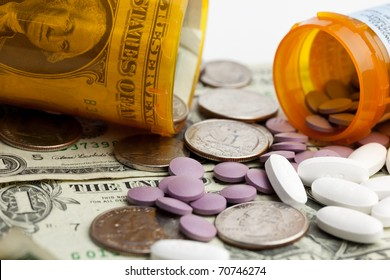 A close-up image of pills, money and prescription bottles to illustrate the cost of healthcare. / MEDICATION COSTS