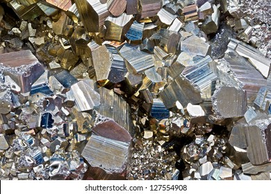 Close-up image of pyrite (fool's gold) crystals at 2x magnification.