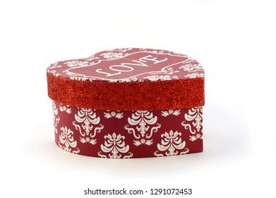 Closeup image of a red fancy heart shaped box for celebrating occasions of love and romance.