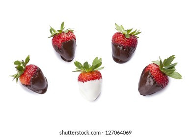 Close-up image of red strawberries with a chocolate dip over the white background