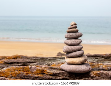 Close-up image of a rocks tower on a rocky beach in Brittany, France.