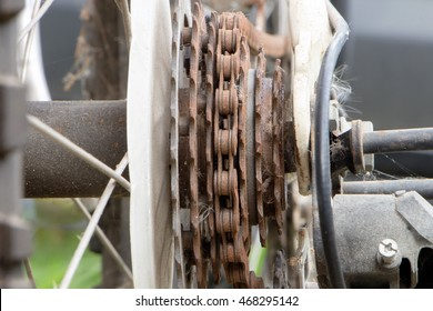 Closeup image of rusty bicycle sprocket and chain